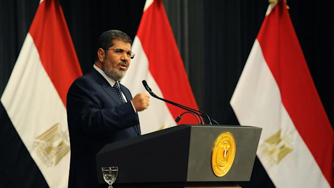 CORRECTS DATE - In this Wednesday, June 26, 2013 image released by the Egyptian Presidency, Egyptian President Mohammed Morsi delivers a speech, in Cairo, Egypt. Morsi told his opponents to use elections not protests to try to change the government and said the military should focus on its role as the nation's defenders in a nationally televised address on Wednesday, days before the opposition plans massive street rallies aimed at removing him from office. (AP Photo/Egyptian Presidency)
