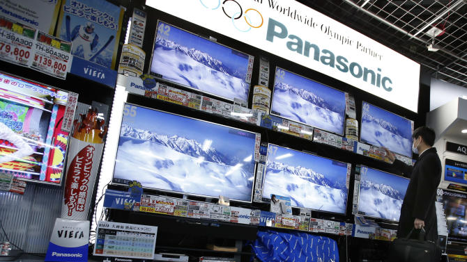 FILE - In this Feb. 4, 2014 file photo, a shopper looks at Panasonic's flat-panel televisions at an electronics retail store in Tokyo. Panasonic returned to profit after deep losses for the past two fiscal years, as a weak yen and restructuring efforts helped a gradual recovery, and forecast a 16 percent increase in gains for the coming year. The Osaka-based maker of the Lumix camera and Evolta batteries reported Monday, April 28, 120.4 billion yen ($1.2 billion) in profit for the fiscal year through March 2014, a reversal from a 754.3 billion yen loss the previous fiscal year. (AP Photo/Shizuo Kambayashi, File)