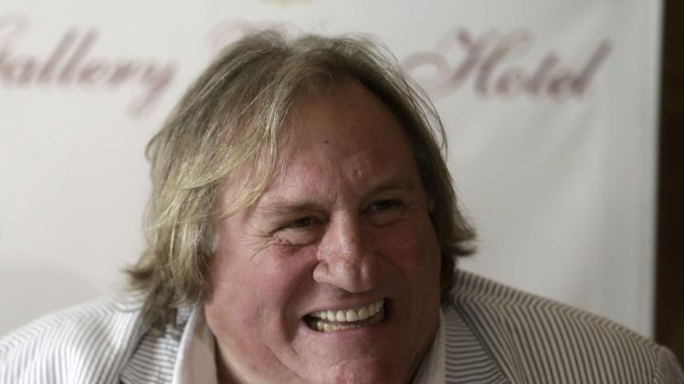 French actor Depardieu smiles during a news conference in Riga