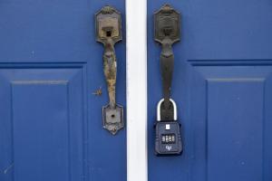 A lockbox hangs on the door of the former Minus Funeral…