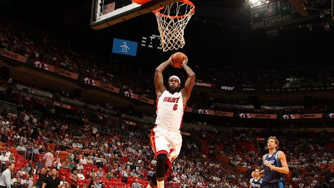 LeBron's 39 points lift Heat past Mavs, 110-104