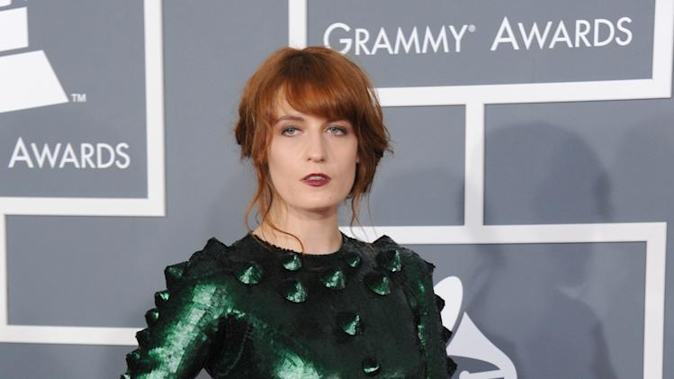 Florence Welch, of Florence and the Machine, arrives at the 55th annual Grammy Awards on Sunday, Feb. 10, 2013, in Los Angeles.  (Photo by Jordan Strauss/Invision/AP)
