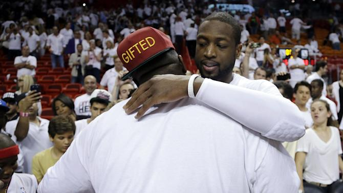 Miami Heat's Dwyane Wade, right, hugs rapper Rick Ross, left, following Game 2 of their NBA basketball playoff series in the Eastern Conference semifinals against the Chicago Bulls, Wednesday, May 8, 2013, in Miami. The Heat won 115-78. (AP Photo/Lynne Sladky)