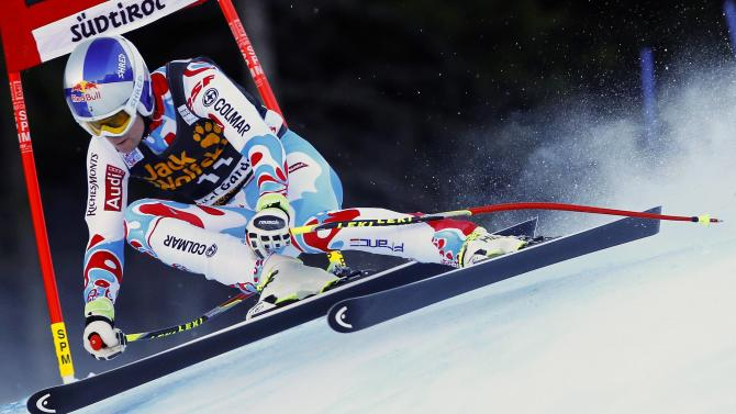 Pinturault of France clears a gate during the men's World Cup Super-G skiing race in Val Gardena