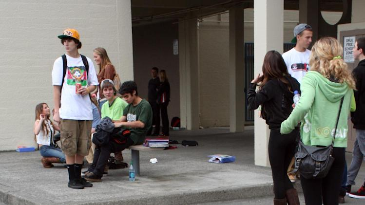 In this photo provided by the Arcata High School Pepperbox, Arcata High School students wear green colored clothing in tribute to fellow student Gregory Kulijan Monday, Nov. 26, 2012, at Arcata High School in Arcata, Calif. The Kuljian family were out for a walk Saturday, Nov. 24 at Big Lagoon beach, playing fetch with their dog when Gregory Kuljian tossed a stick that took their dog down to the water's edge. Kuljian's son ran to save the dog, and struggled as he was captured by the surging surf. Howard Kuljian followed, and later his wife. Both parents' bodies were later recovered, but the boy, presumed dead, is still missing. (AP Photo/Arcata High School Pepperbox, Forrest Lewis)