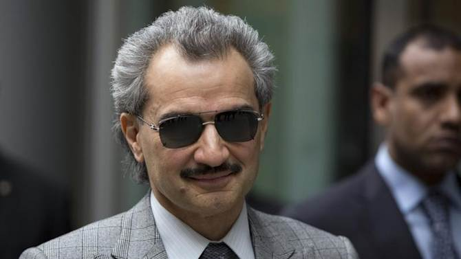 File photograph shows Prince Alwaleed bin Talal leaving the High Court in London