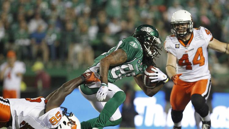 Saskatchewan Roughriders' wide receiver Smith gets tackled on the play by BC Lions' linebacker Elimimian during the second half of their CFL football game in Regina