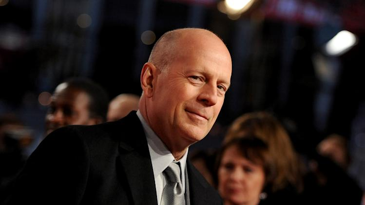 In this picture made available Tuesday Feb. 5, 2013,  US actor Bruce Willis , arrives  for the premiere of the movie  'A Good Day to Die Hard' in Berlin, Germany, Monday Feb. 4, 2013.   (AP Photo/dpa, Britta Pedersen)