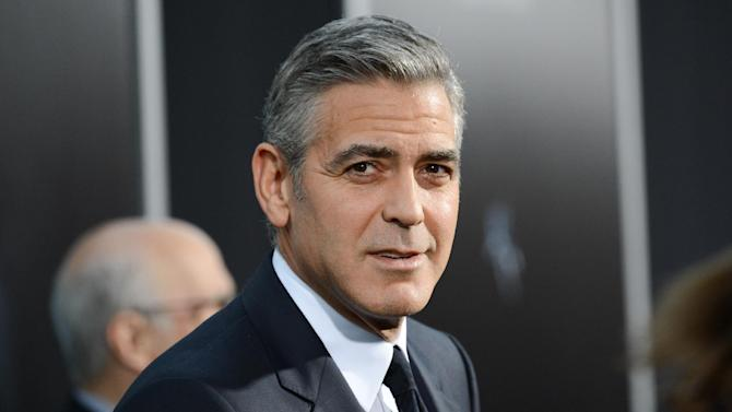 """FILE - In this Oct. 1, 2013 file photo, actor George Clooney attends the premiere of """"Gravity"""" at the AMC Lincoln Square Theaters, in New York. The Britannia Awards, handed out by the Los Angeles branch of the British Academy of Film and Television Arts, promise an all-star cast. Presenters including Julia Roberts, Sean Penn, Sigourney Weaver and Chiwetel Ejiofor will honor recipients such as Clooney, Ben Kingsley, Kathryn Bigelow, and Sacha Baron Cohen, on Saturday, November 9, 2013, at the Beverly Hilton Hotel, in Los Angeles. (Photo by Evan Agostini/Invision/AP, File)"""