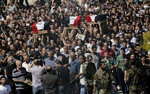 The funeral procession in Damascus on September 10, …