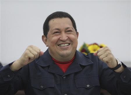 Venezuela's President Hugo Chavez reacts while speaking in a video conference with Argentina's counterpart Cristina Fernandez de Kirchner in Caracas