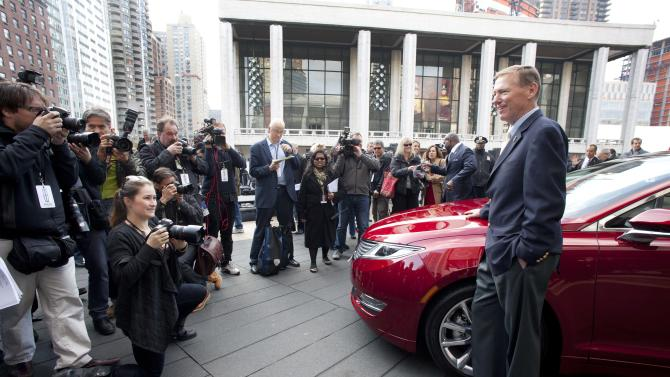 Ford Motor Co. President and CEO Alan Mulally, stands next to a Lincoln MKZ as he poses for photographers, Monday, Dec. 3, 2012 in New York. The MKZ will arrive at dealerships this month. The MKZ is the first of seven new or revamped Lincolns that will go on sale by 2015. (AP Photo/Mark Lennihan)
