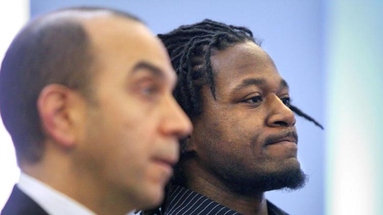 "Cincinnati Bengals cornerback Adam ""Pacman"" Jones, right, appears in Hamilton County Municipal Court in Cincinnati with his lawyer, Ed Perry, Wednesday, Jan. 18, 2012. Jones pleaded guilty to a misdemeanor charge of disorderly conduct.  Jones was ordered to serve a year of probation, complete 50 hours of community service and pay a $250 fine plus court costs.  (AP Photo/The Enquirer, Carrie Cochran) NO SALES"