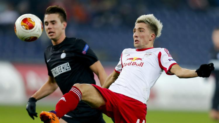 Salzburg's Kevin Kampl challenges Esbjerg fB's Jonas Knudsen during their Europa League soccer match in Salzburg