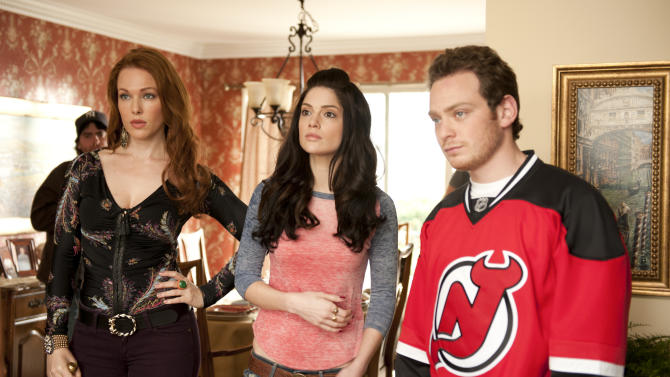 "This image released by CBS shows Erin Cummings as Bonnie, Janet Montgomery as  Martina and Joe Siravo as Albert in the CBS series ""Made in Jersey,"" premiering Sept. 28, at 9 p.m. EST. (AP Photo/CBS, David Lee)"
