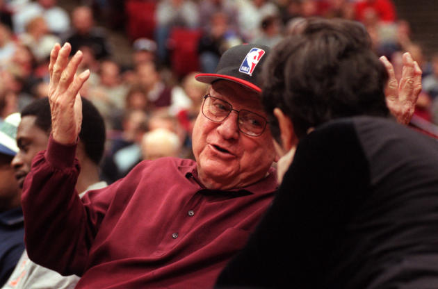 In this Dec. 5, 2000, photo, Minnesota Timberwolves owner Marv Wolfenson talks with Marge Weiser during halftime of the NBA basketball game between the Timberwolves and the Chicago Bulls in Minneapoli