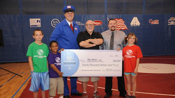 IMAGE DISTRIBUTED FOR BOYS & GIRLS CLUBS OF AMERICA - In this image released on Friday, April 12, 2013, the Maytag Repairman, Ray Black Jr. and Boys & Girls Club alumni Michael Galbreath pose with club kids as Maytag brand and Boys & Girls Clubs of America (BGCA) honor Ray Black Jr., executive director at the Lide White Memorial Boys & Girls Club in Madison, Ind. Black received a 2013 Maytag Dependable Leader Award and a $20,000 grant for his dependability and commitment to the organization. Awarded by Maytag brand and Boys & Girls Clubs of America (BGCA), the $20,000 grant will further extend the organization's efforts in helping youth achieve great futures. (Brian Bohannon/AP Images for Boys & Girls Clubs of America)