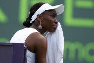 Venus Williams wipes her face during her match against Kimiko Date-Krumm, of Japan, at the Sony Ericsson Open tennis tournament, Wednesday, March 21, 2012, in Key Biscayne, Fla. (AP Photo/Lynne Sladky)
