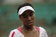 Venus Williams of the U.S. reacts during her match against Agnieszka Radwanska of Poland during the French Open tennis tournament at the Roland Garros stadium in Paris May 30, 2012. REUTERS/Gonzalo Fuentes