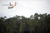 A Jayhawk helicopter operated by the U.S. Coast Guard continues search and rescue operations for captain Robin Walbridge of the tall ship HMS Bounty, which turned on its side 90 miles southeast of Hatteras, N.C. during Hurricane Sandy on Monday, in Elizabeth City, N.C., Tuesday, Oct. 30, 2012. Sandy, the storm that made landfall Monday, caused multiple fatalities, halted mass transit and cut power to more than 6 million homes and businesses. (AP Photo/The Virginian-Pilot, Amanda Lucier) MAGS OUT
