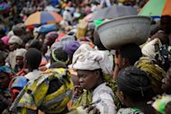 <p>A displaced Congolese woman waits for humanitarian aid in a camp for the internally displaced in Mugunga.</p>