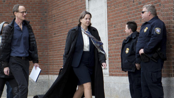 Defense attorney Judy Clarke, center, arrives at federal court, Monday, April 27, 2015, in Boston, during the penalty phase of the federal trial of Dzhokhar Tsarnaev, who was convicted of the Boston Marathon bombings that killed three and injured 260 people in April 2013. (AP Photo/Justin Saglio)