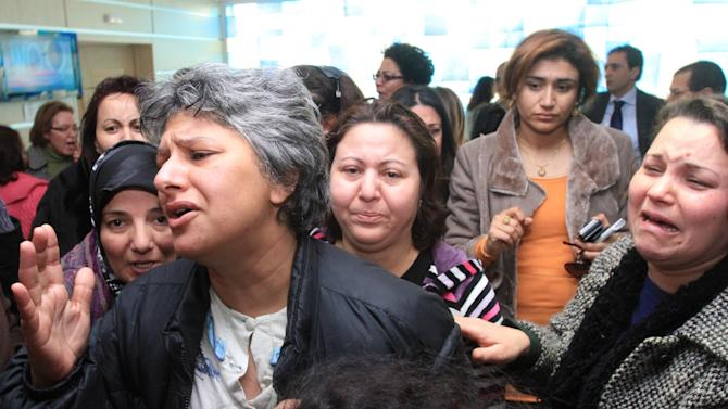 Besma Khlifi, left, wife of Tunisian opposition leader Chokri Belaid, reacts after he was shot to death in Tunis, Wednesday, Feb. 6, 2013.  A critic of the Islamist-led government and violence by radical Muslims, Belaid was shot to death outside his home Wednesday, in the first political assassination in post-revolutionary Tunisia. The killing is likely to heighten tensions in the North African nation whose path from dictatorship to democracy so far has been seen as a model for the Arab world. (AP Photo/Amine Landoulsi)