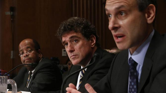 Ousted IRS Chief Steve Miller, center, flanked by former IRS Commissioner Douglas Shulman, right, and J. Russell George, Treasury Inspector General for Tax Administration, listens on Capitol Hill, in Washington, Tuesday, May 21, 2013, during the Senate Finance Committee hearing on the Internal Revenue Service (IRS) practice of targeting applicants for tax-exempt status based on political leanings. (AP Photo/Charles Dharapak)