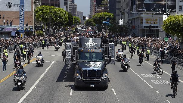 One of the vehicles carrying the of the Stanley Cup trophy moves along a parade route, Monday, June 16, 2014, in Los Angeles.  The parade and rally were held to celebrate the Los Angeles Kings' second Stanley Cup championship in three seasons. The Kings defeated the New York Rangers for the title