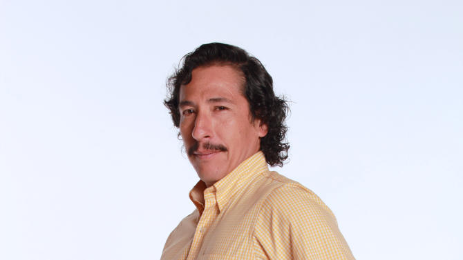 "FILE - In this 2012 promotional file photo provided by RCN Television, actor Elkin Diaz poses in character as Vicente Castano for the television series ""Tres Caines,"" or ""Three Cains,"" an allusion to the Biblical story of Cain slaying his brother Abel, in Bogota, Colombia.  The soap opera has stirred unprecedented controversy by dramatizing _ and some say romanticizing _ the career of the Castano brothers, central figures in the creation of the country's murderous far-right militias. (AP Photo/RCN Television, File)"