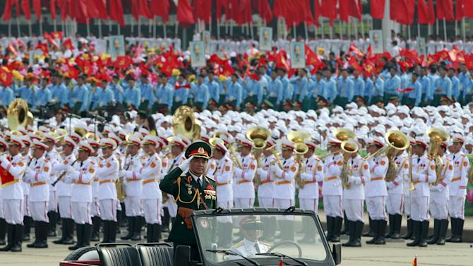 Lieutenant General Vo Van Tuan, deputy chief of general staff salutes as he leads a parade marking their 70th National Day at Ba Dinh square in Hanoi, Vietnam