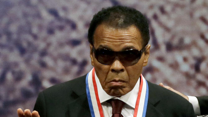 Retired boxing champion Muhammad Ali waves after receiving the Liberty Medal during a ceremony at the National Constitution Center, Thursday, Sept. 13, 2012, in Philadelphia. The honor is given annually to an individual who displays courage and conviction while striving to secure liberty for people worldwide. (AP Photo/Matt Slocum)