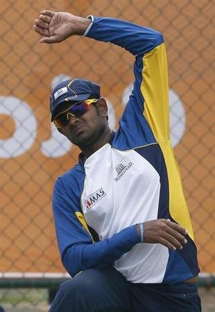 Sri Lanka's Thirimanne stretches during a practice session ahead of the World Twenty20 cricket match against South Africa in Hambantota