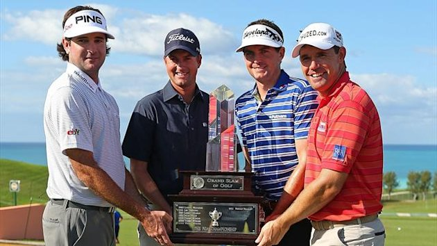 Bubba Watson, Webb Simpson, Keegan Bradley, and Padraig Harrington pose with the Grand Slam Trophy