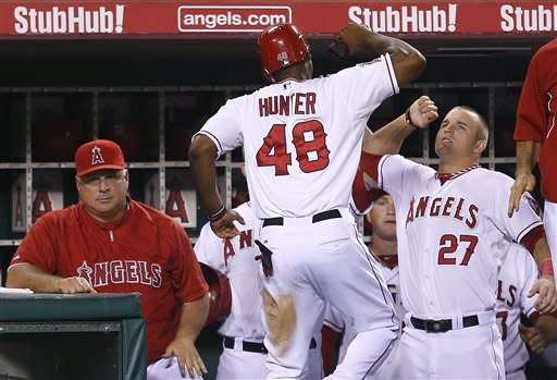 Angels smack Rangers 11-3, stay in playoff chase