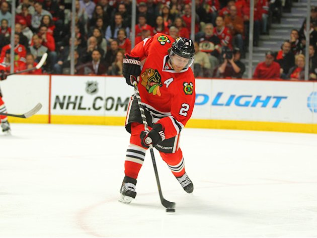 May 2, 2014; Chicago, IL, USA; Chicago Blackhawks defenseman Duncan Keith (2) clears the puck during the second period of game one of the second round...