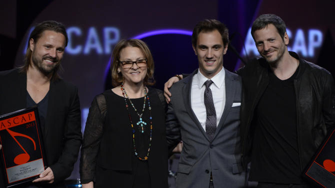 """Songwriter Max Martin, ASCAP's  Brendan Okrent, ASCAP's  Evan Trindl and songwriter Dr Luke received the ASCAP Pop Song Award for """"Part of Me"""" are seen onstage at the 30th Annual ASCAP Pop Music Awards, on Wednesday, April 16, 2013, at Loews Hollywood Hotel in Hollywood, California. (Photo by Phil McCarten/Invision for ASCAP/AP Images)"""
