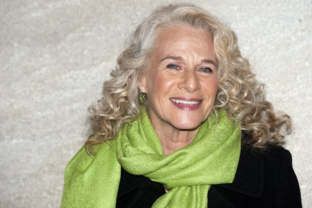 FILE - In this Nov. 30, 2011 file photo, musician Carole King attends the Rockefeller Center Christmas tree lighting, in New York. King, now a best-selling author, doubts she will ever write another song and suggested that her 2010 &quot;Troubadours Reunion&quot; concert tour with James Taylor would be her last. She recently released a memoir called, &quot;A Natural Woman.&quot; (AP Photo/Charles Sykes, file)