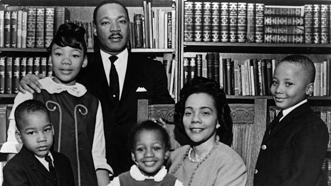 "FILE - This 1966 file photo is the last official portrait taken of the entire King family, made in the study of Ebenezer Baptist Church in Atlanta. From left are Dexter King, Yolanda King, Martin Luther King Jr., Bernice King, Coretta Scott King and Martin Luther King III. In 1963, Martin Luther King Jr. declared, ""I have a dream that my four little children will one day live in a nation where they will not be judged by the color of their skin but by the content of their character."" (AP Photo/Atlanta Journal-Constitution, File)"