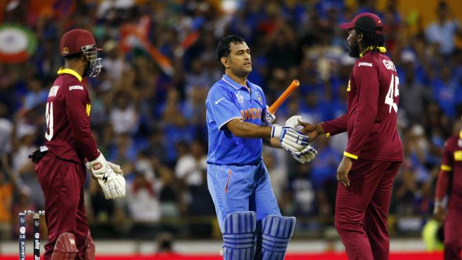 India's captain MS Dhoni shakes hands with West Indies' Chris Gayle after India defeated the West Indies by four wickets at the Cricket World Cup in Perth