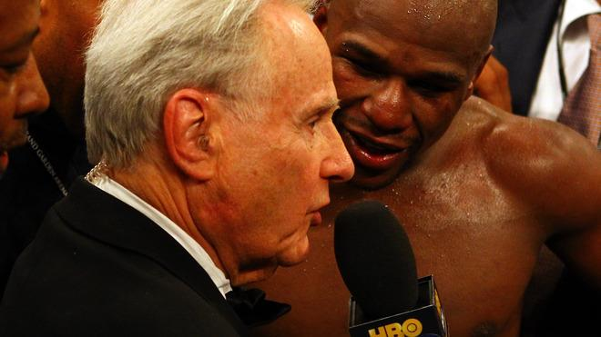 Floyd Mayweather talks with Larry Merchant after a fight.