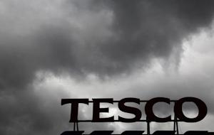 Grey clouds hang over a Tesco Extra store in New Malden southwest London