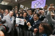 Prime Minister Shinzo Abe of Japan (C) celebrates with members of the Tokyo bid committee as Jacques Rogge President of the International Olympic Committee (IOC) announces Tokyo as the city to host the 2020 Summer Olympic Game during a ceremony in Buenos Aires September 7, 2013. REUTERS/Marcos