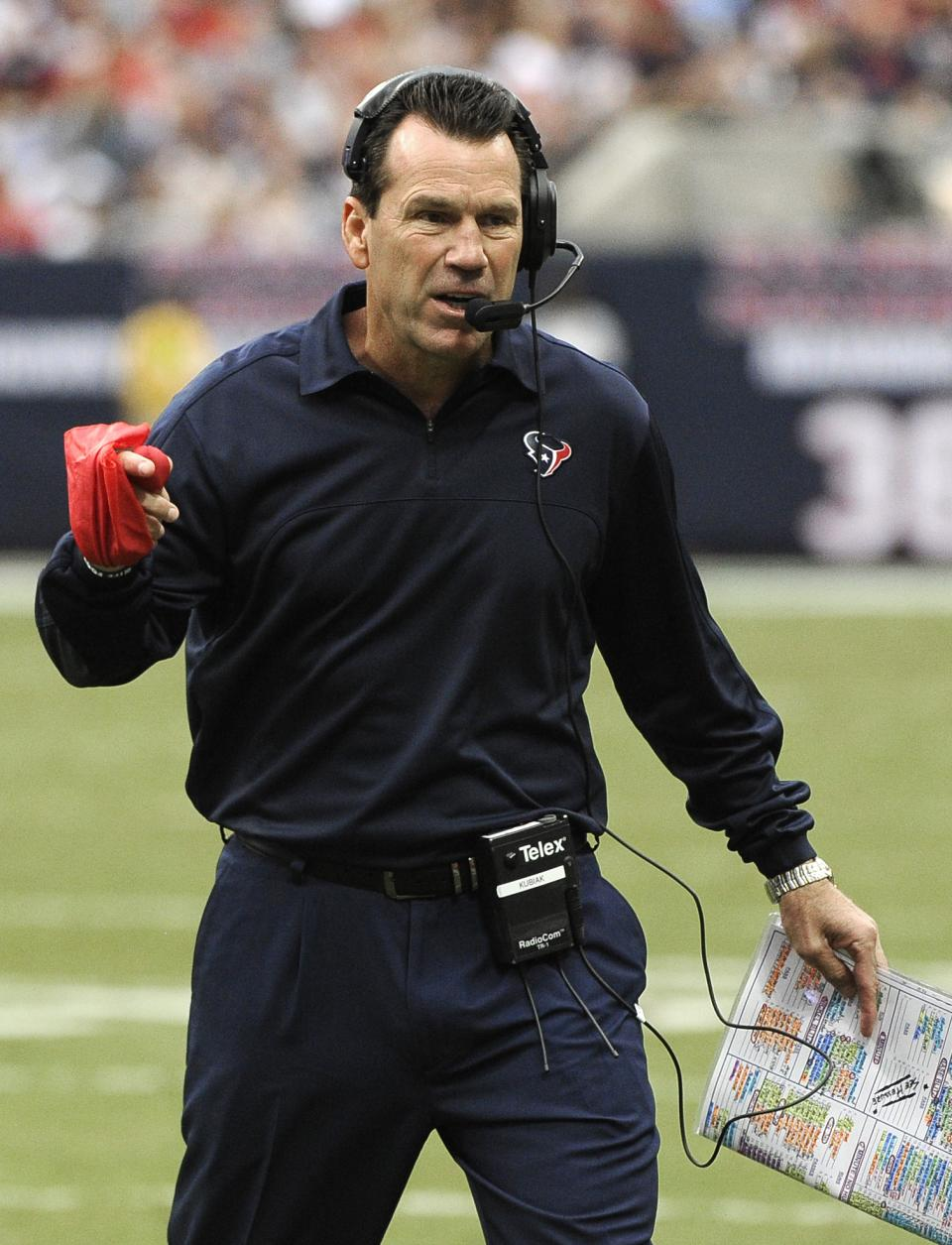 Houston Texans coach Gary Kubiak waves a red flag to challaenge a first down call in the first quarter of an NFL football game against the Tennessee Titans Sunday, Sept. 30, 2012, in Houston. (AP Photo/Dave Einsel)