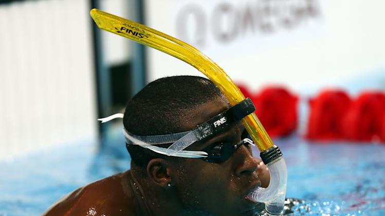 Grenada swimmer Esau Simpson trains for the 2012 Summer Olympics on Wednesday July 25, 2012 in London. (AP Photo/David Davies, PA) UNITED KINGDOM OUT; NO SALES; NO ARCHIVE