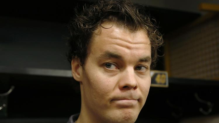 Boston Bruins goalie Tuukka Rask, of Finland, listens to a reporter's question in the team's locker room at TD Garden Friday, May 16, 2014, in Boston. The Montreal Canadiens eliminated the Bruins with a 3-1 win in Game 7 of their second-round Stanley Cup playoff NHL hockey series on Wednesday