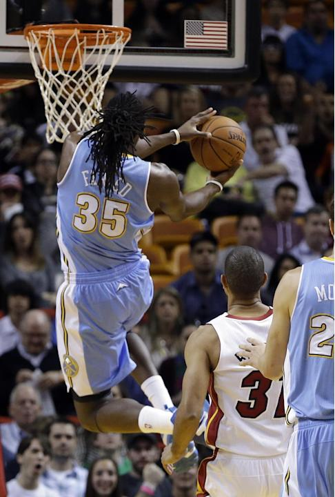 Denver Nuggets forward Kenneth Faried (35) goes to the basket against the Miami Heat during the first half of an NBA basketball game in Miami, Friday, March 14, 2014
