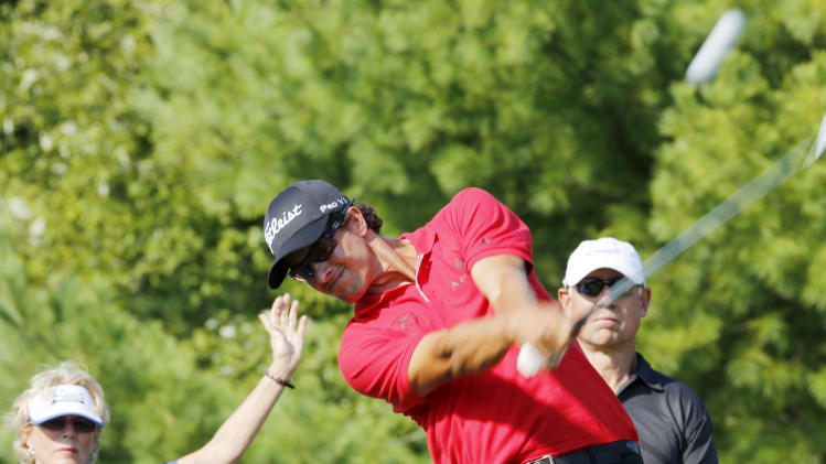 Adam Scott tees of on the third hole during the Pro-Am of the Deutsche Bank Championship golf tournament at TPC Boston in Norton, Mass., Thursday, Aug. 30, 2012. (AP Photo/Michael Dwyer)