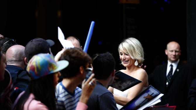 U.S. actress Cameron Diaz signs autographs as she arrives for the European premiere of the movie 'What to Expect When You're Expecting' at a cinema in London, Tuesday, May 22, 2012.  (AP Photo/Matt Dunham)