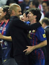 Barcelona&#39;s coach Josep Guardiola (L) embraces Barcelona&#39;s forward Lionel Messi at the end of the Spanish King&#39;s Cup final. Barcelona gave Guardiola the perfect send off Friday, beating Athletic Bilbao 3-0 in Madrid to win the Spanish Cup in the coach&#39;s last match in charge after a memorable four seasons in the Catalan hot seat